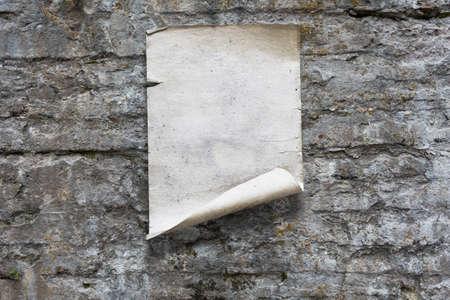 old paper on stone wall Zdjęcie Seryjne - 129845023