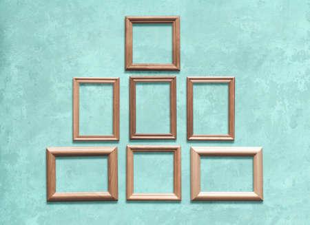 old wooden frames on blue wall Zdjęcie Seryjne - 129845106
