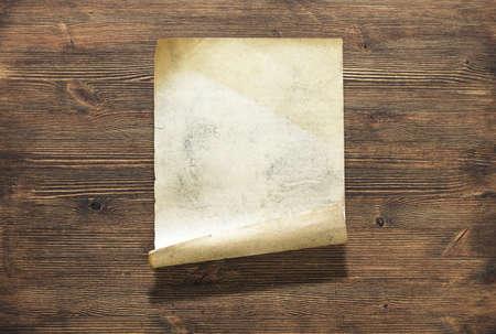 old paper on wooden background Zdjęcie Seryjne - 129845195