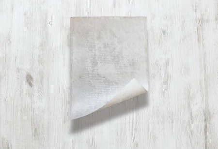 old paper on white wooden background Zdjęcie Seryjne - 129845258