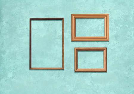 old wooden frames on blue wall Zdjęcie Seryjne - 129845271