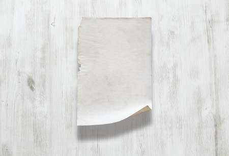 old paper on white wooden background Zdjęcie Seryjne - 129845254