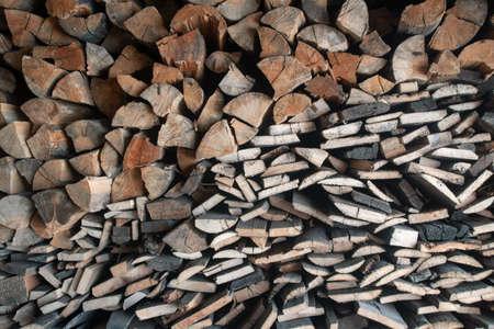 Firewood stack, chopped wood background. Zdjęcie Seryjne