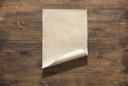 old paper on wooden background Zdjęcie Seryjne