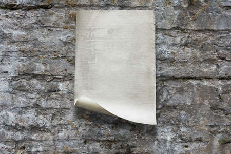 old paper on stone wall