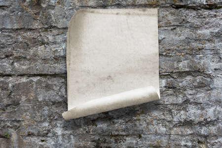 old paper on stone wall Фото со стока - 132752361