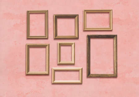 old wooden frames on pink wall Фото со стока - 132752366
