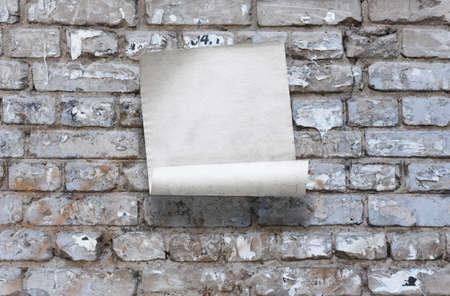 old paper on brick wall Фото со стока - 132752375