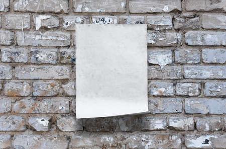 old paper on brick wall Фото со стока - 132752377