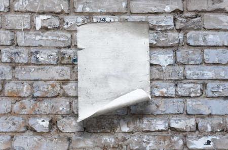 old paper on brick wall Фото со стока - 132752383