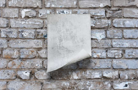 old paper on brick wall Фото со стока - 132752413