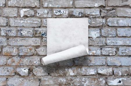 old paper on brick wall Фото со стока - 132752451