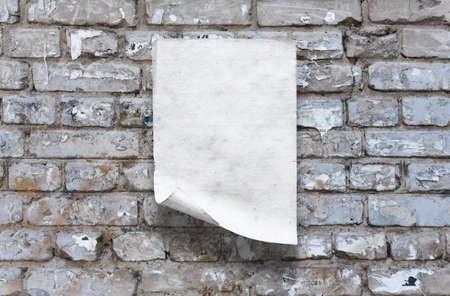 old paper on brick wall Фото со стока - 132752464