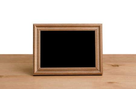 cornice per foto sul tavolo, sfondo bianco Archivio Fotografico