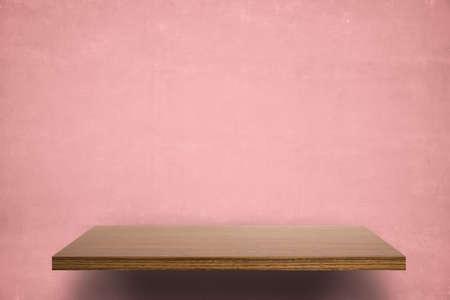 empty shelf on pink wooden wall Фото со стока