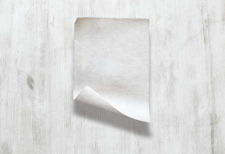 old paper on white wooden background Фото со стока