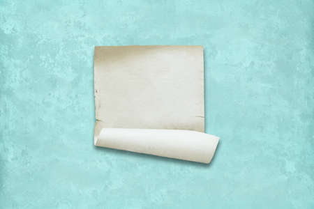 old paper on wall, mint blue background