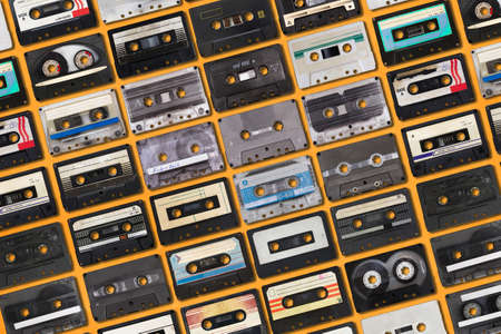 collection of retro audio tapes on yellow background Фото со стока