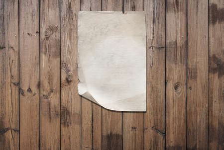 white paper on old wooden wall, background with copy space