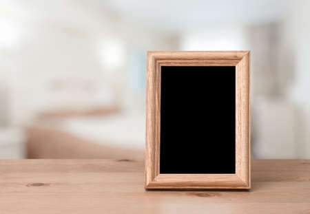 photo frame on the wooden table in the bedroom Zdjęcie Seryjne