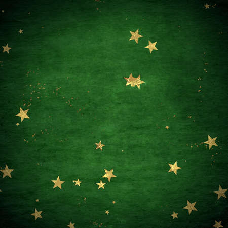 Christmas confetti, golden glitter texture on a dark background. Zdjęcie Seryjne