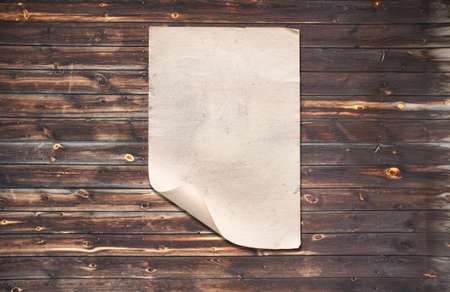 white paper on old wooden wall, background with copy space Zdjęcie Seryjne - 157855741
