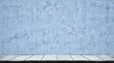 Studio table background with blue wall