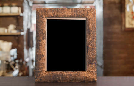 old photo frame on the wooden table in a night club Zdjęcie Seryjne