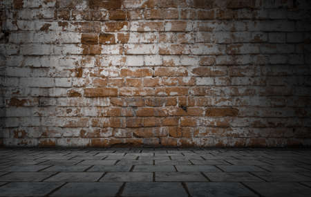 Empty room with bricks wall and tiled floor. Dark background.