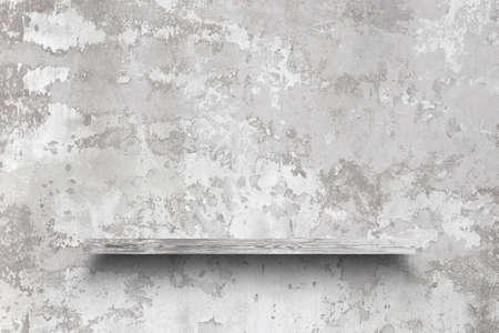 empty shelf on concrete wall
