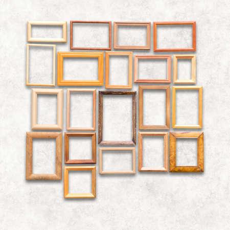 wooden photo frames on white wall 免版税图像