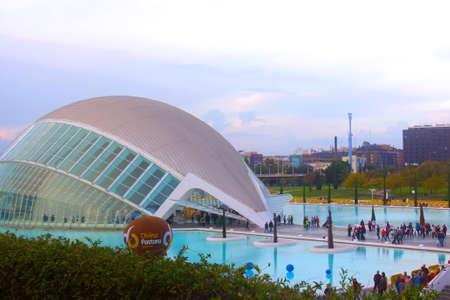 hemispheric: VALENCIA � NOVEMBER 17: The Hemispheric on November 17, 2012 in Valencia, Spain. Unidentified people walking near the reflection pool at the Hemispheric building in the City of Arts and Sciences in twilight.