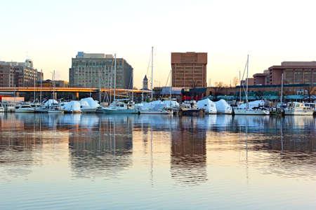 East Potomac Washington channel at sunrise  Yachts and city skyline reflections  photo