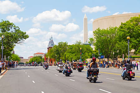 WASHINGTON, DC, USA - MAY 25, 2014: Memorial Day weekend motorbikes rally travels towards National Monument as part of the annual Rolling Thunder motorcycle ride for American POWs and MIA soldiers on May 25, 2014 in Washington, DC, USA