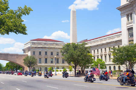 WASHINGTON, DC, USA - MAY 25, 2014: Memorial Day weekend motorbikes rally on Independence Avenue with National Monument in a view. Annual Rolling Thunder motorcycle ride for American POWs and MIA soldiers on May 25, 2014 in Washington, DC, USA