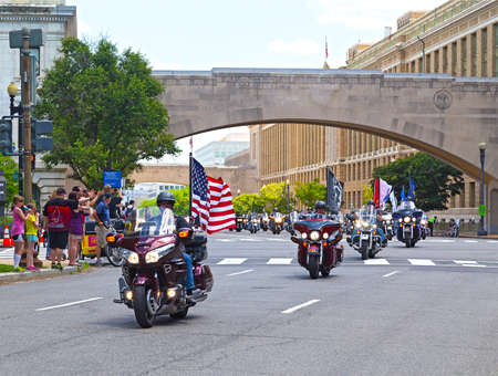 WASHINGTON, DC, USA - MAY 25: Motorcycles travel down Independence Avenue as part of the annual Rolling Thunder motorcycle ride for American POWs and MIA soldiers on May 25, 2014 in Washington, DC, USA. Rolling Thunder Parade.