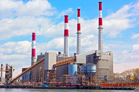 power operated: NEW YORK, USA - JUNE 29, 2014: Ravenswood Generating Station in the morning on April 26, 2014 in New York. The power plant uses natural gas, fuel oil and kerosene to power its boilers and operated by TransCanada.