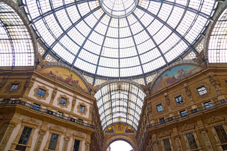 Vittorio Emanuele II gallery in Milan, Italy  Famous shopping center with glass dome and ornaments