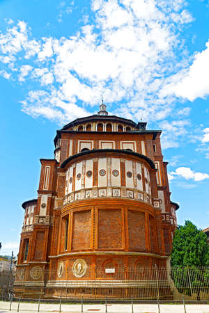 "last supper: Church of Santa Maria delle Grazie under blue sky in Milan, Italy  This church is famous for hosting Leonardo da Vinci's masterpiece ""The Last Supper""  Stock Photo"