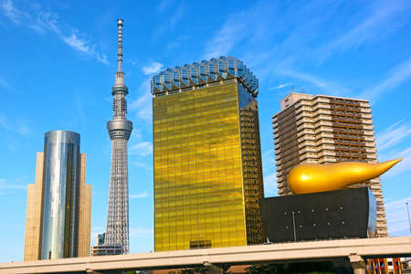 flamme: Landmark buildings line along Sumida River in Asakusa in Tokyo, Japan Editorial
