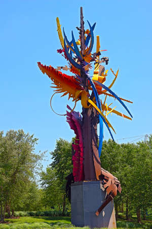 americal: NATIONAL HARBOR, MARYLAND, USA - JULY 4, 2014: \\\The Beconing\\\ sculpture photographed on July 4, 2014 in National Harbor, Maryland, USA. The sculpture of Albert Paley captures the Americal spirit with vibrant colors extending into the sky. Editorial