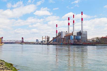 power operated: NEW YORK, USA - JUNE 29, 2014: Ravenswood Generating Station in the morning on April 26, 2014 in New York, USA. The power plant uses natural gas, fuel oil and kerosene to power its boilers and operated by TransCanada.