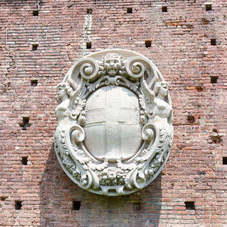 sforza: Coat of arms bas-relief on the wall of Sforza castle in Milan, Italy. Ancient restored coat of arms bas-relief on the wall of castle.