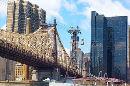 lower east side: Roosevelt Island Tramway and Queensboro Bridge in New York. Connection between Roosevelt Island with Lower East Side Manhattan.