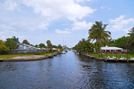 Motorboats moored along the canal in suburb of Miami, Florida. Urban scenic landscape in suburban Miami, Florida. photo