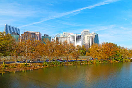 theodore roosevelt: Rosslyn scenic skyline and Potomac river bank in autumn. Office buildings viewed from Theodore Roosevelt Bridge, Washington DC.