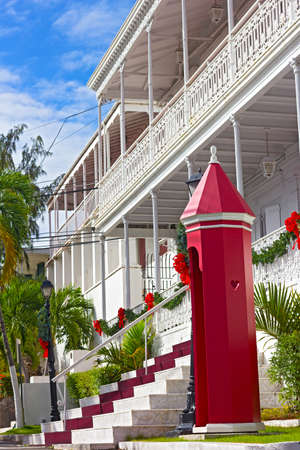 ironwork: CHARLOTTE AMALIE, ST THOMAS, US VI - DECEMBER 18: Government house in Christmas decorations in Charlotte Amalie on December 18, 2014. The house building has beautifully intricate ironwork along the balconies.