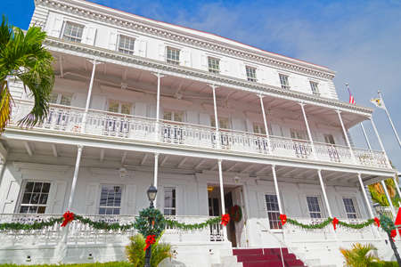 ironwork: CHARLOTTE AMALIE, ST THOMAS, US VI - DECEMBER 18: Government house facade in Christmas decorations in Charlotte Amalie on December 18, 2014. The house building has beautifully intricate ironwork along the balconies. Editorial