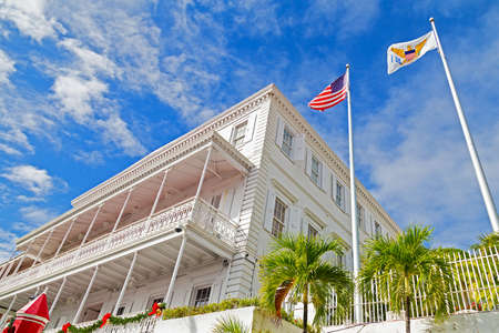 three story: CHARLOTTE AMALIE, ST THOMAS, US VI - DECEMBER 18: Gracious three story Government house in Charlotte Amalie on December 18, 2014. The house building has beautifully intricate ironwork along the balconies.