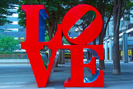 public project: TOKYO, JAPAN - JUNE 29, 2013: Love Sculpture on June 29, 2013 in Tokyo, Japan. Designed by Robert Indiana sculpture is a part of Shinjuku I-Land public art project. Editorial